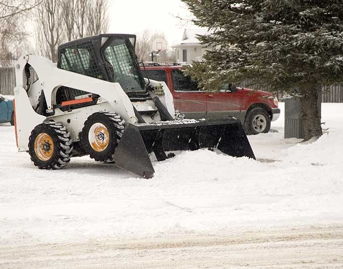 Clearing Snow Via Bobcat